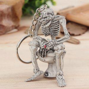 CAVEIRA HUM Esqueleto na chave do toalete chaveiro anel novidade presente de borracha / anel de metal R$35,00  FRETE GRATIS SITE aqui www.DUGEZZU.com.br boas comprastes